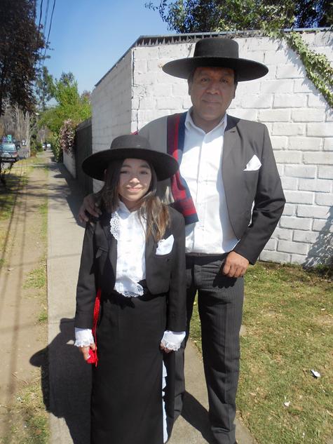 An adorable daddy-daughter duo in huaso elegante attire.