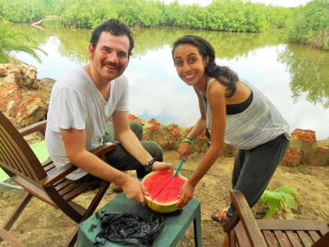 My sitemates Bill and Kimia slicing up a watermelon by the river.