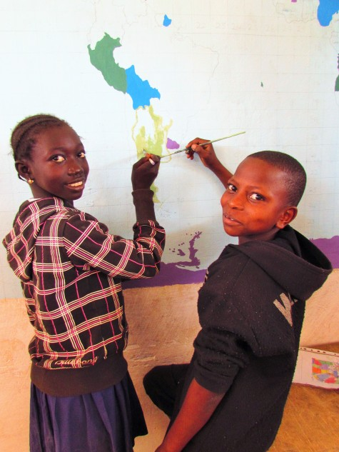 Isatou and Dawda, grade 5 students, paint Argentina (home of Messi!)