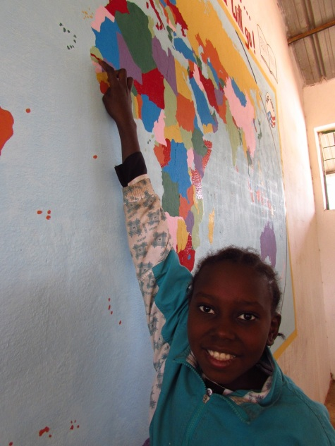 Maimunia, Grade 6, finds her country on the map.