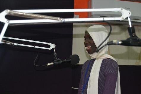 My sister Jainaba talking on the radio.